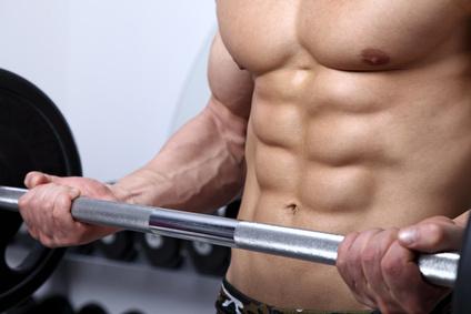 Bodybuilder exercising in Gym